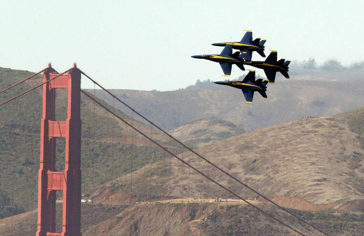 The Blue Angels fly near the Golden Gate Bridge, seen in October 2019 from the Fairmont Hotel.