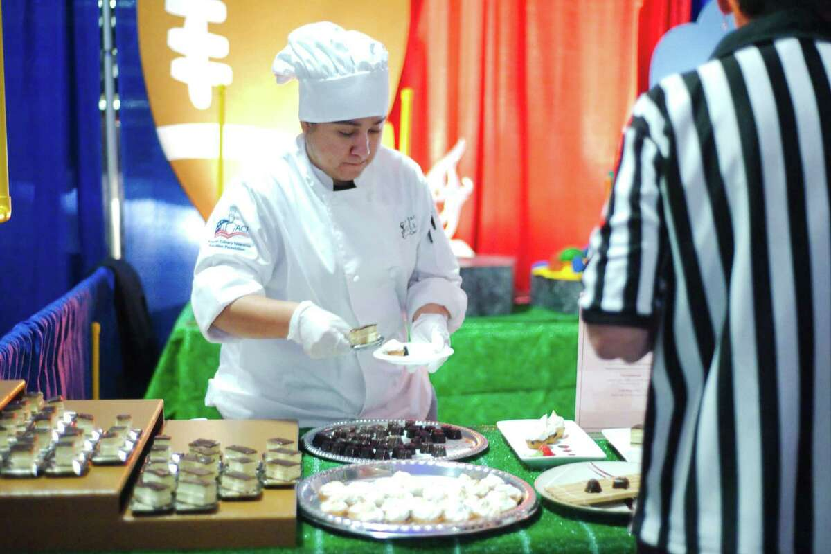 Samantha Vargis serves desserts at the San Jacinto College Central Culinary Arts and Restaurant Management booth during the Pasadena Chamber of Commerce's Taste of the Town in 2015. The 32-year tradition continues Nov. 4 at the Pasadena Convention Center.