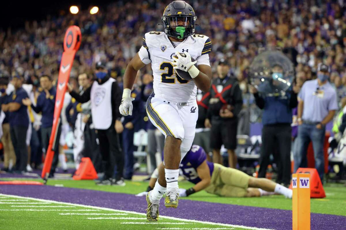 SEATTLE, WASHINGTON - SEPTEMBER 25: Damien Moore #28 of the California Golden Bears runs for a touchdown during the fourth quarter against the Washington Huskies at Husky Stadium on September 25, 2021 in Seattle, Washington. (Photo by Abbie Parr/Getty Images)