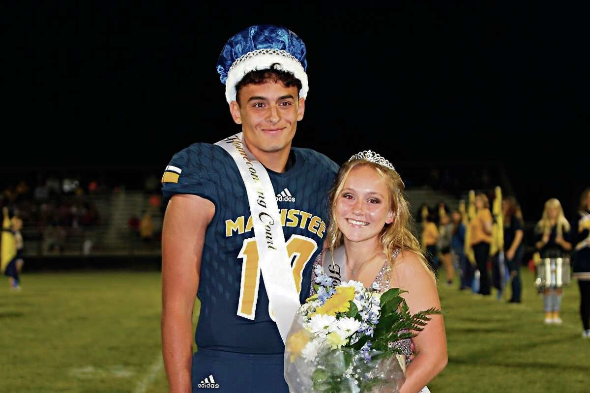 (From left) Trevor Mikula and Addy Witkowski were crowned as Manistee High School homecoming royalty on Thursday at halftime of the Chippewas' 27-0 win over Mason County Central.