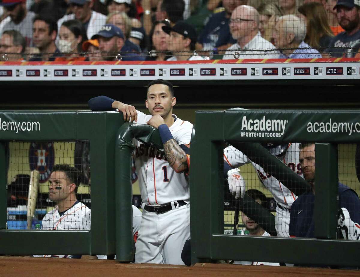 Houston Astros Carlos Correa (1) in the dugout during the first inning of an MLB baseball game at Minute Maid Park, Tuesday, September 28, 2021, in Houston.