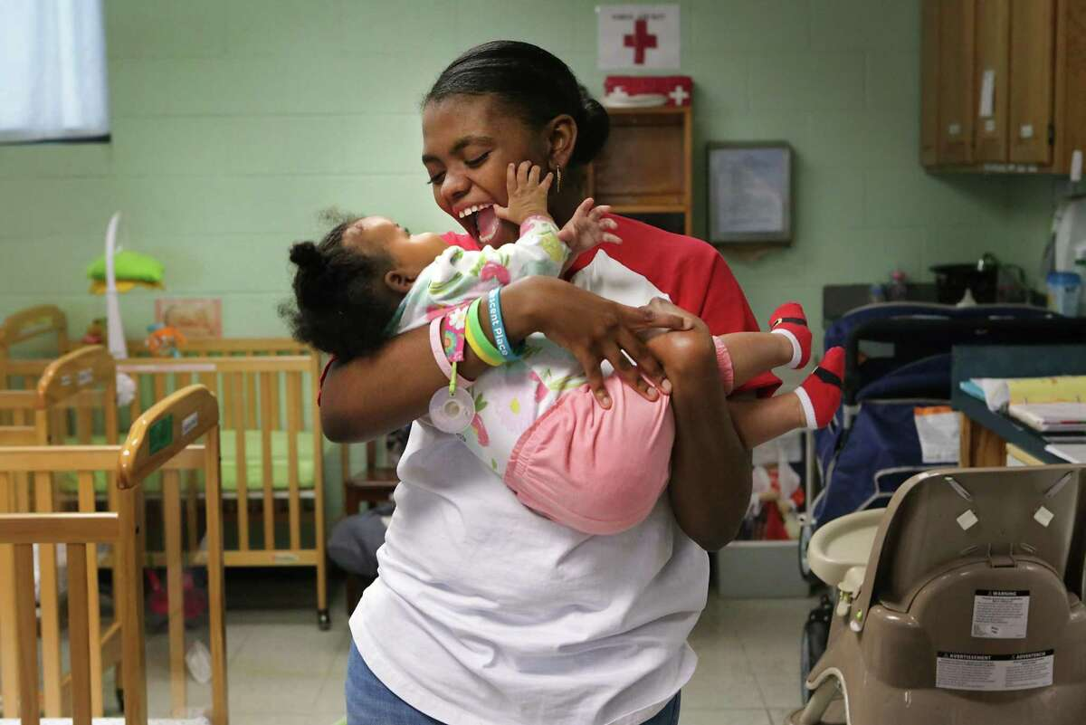 A teen mother holds her daughter at the Healy-Murphy Child Development Center in 2017. The Texas Legislature is also restricting access to sex education and contraception - two proven strategies effective at preventing unintended pregnancies.
