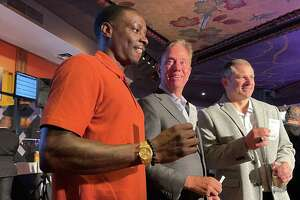 Former UConn football player Darius Butler, who played nine years in the NFL, with Gov. Ned Lamont at Mohegan Sun casino Thursday morning.