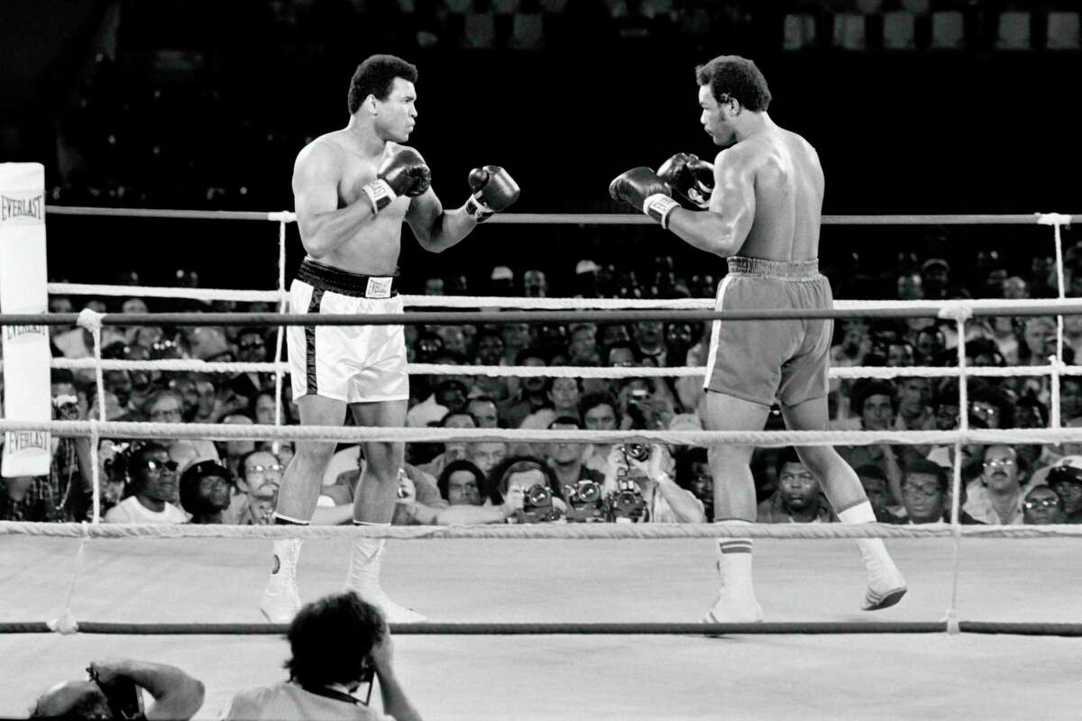 Muhammad Ali, left, squares off with George Foreman in 1974. A new documentary from Ken Burns takes us back in time. Ali is as real, magnificent and large as ever.