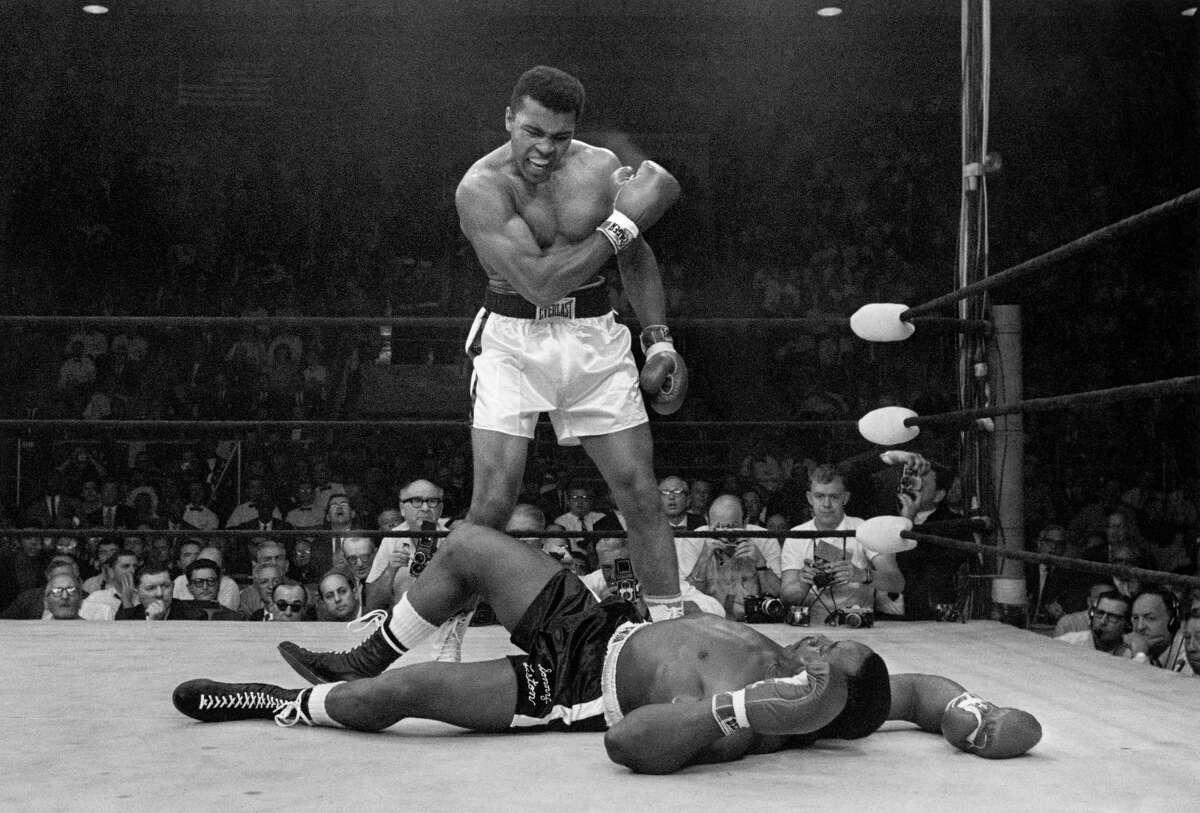 Muhammad Ali stands over fallen Sonny Liston, in 1965.