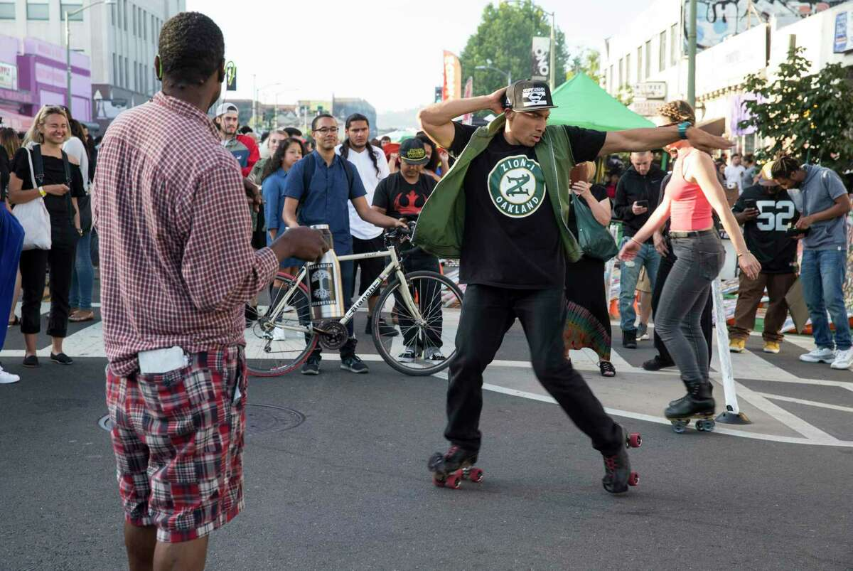 Beto Lopez roller skates for a crowd of spectators during the Oakland First Fridays street festival in Oakland, Calif., on Friday, June 2, 2017. The art, music, food and community festival takes place every first Friday of the month, weather permitting. Telegraph Avenue is closed to traffic between West Grand Avenue and 27th Street for the festivities.