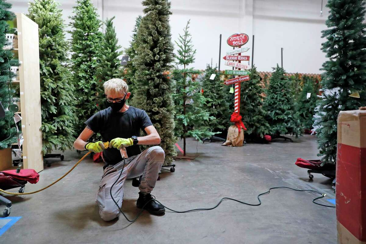 Cosmo Creek turns on the lights for the showroom at Balsam Hill Artificial Christmas Tree Co. in Burlingame, Calif., on Thursday, September 30, 2021. Balsam Hill is among companies affected by slow-downs in the supply chain and big increases in shipping costs.