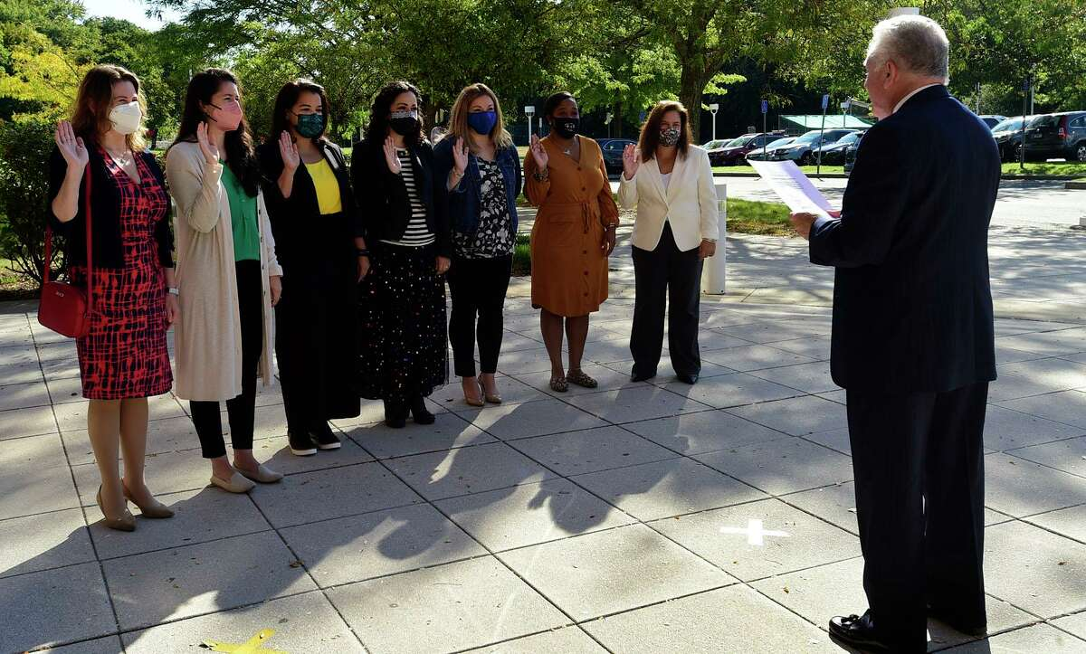 Norwalk Mayor Harry Rilling holds a swearing in ceremony for members of the newly re-established Commission on the Status of Women including Yvonne Zucco, Sarah Rendon Garcia, Sharon Baanante, Iliana Zuniga, Shannnon O'Toole Giandurco, Jasmine Prezzie and Kristina Test Buzzee, Friday, October 1, 2021, at City Hall in Norwalk, Conn.