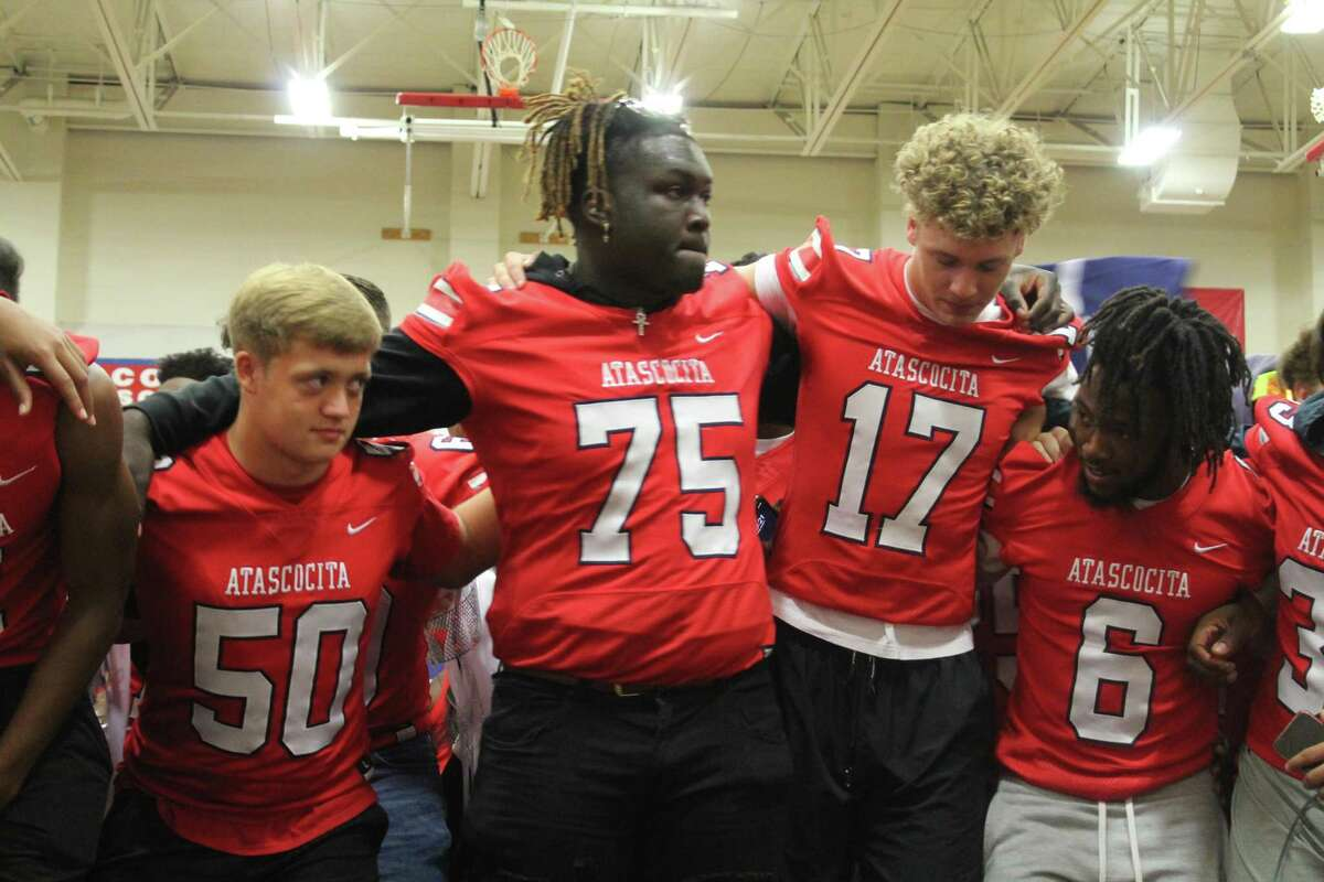 Atascocita offensive lineman Kam Dewberry with his teammates during the pep rally at the Atascocita High school gym.