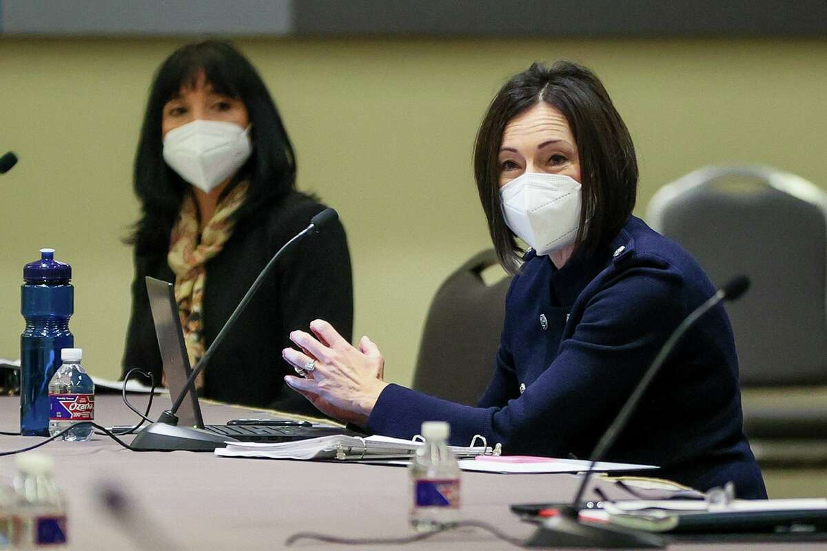 First Assistant City Attorney Liz Provencio, right, speaks while Deputy City Manager Maria Villagómez watches during a negotiating session in February over the city's contract with the San Antonio Police Officers Association.
