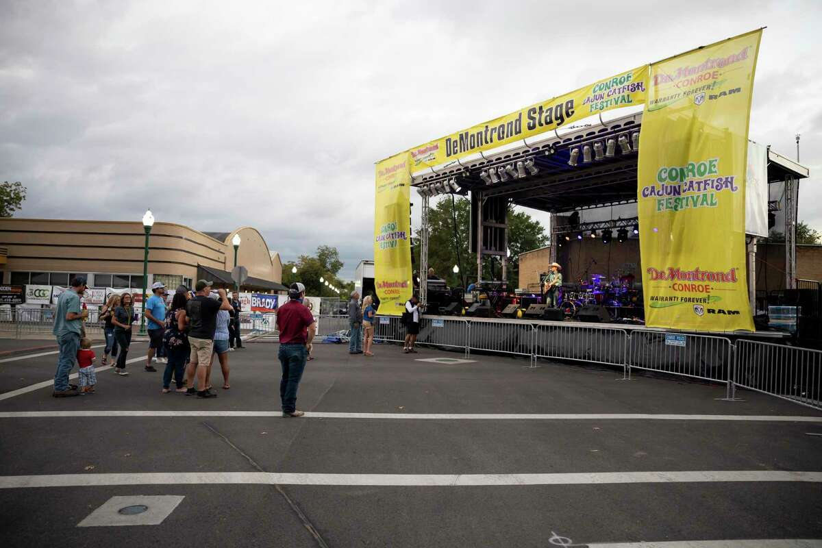 Cannon Brand plays for a small crowd at the Texas stage during the 2020 Conroe Cajun Catfish Festival, Friday, Oct. 9, 2020. This year's event is set for Oct. 8 through Oct. 10 in downtown Conroe.