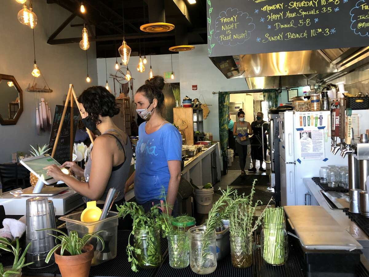 With vaccine mandates for some of Hawaii's islands, restaurants are adapting. In Lahaina, Maui, Moku Roots has decided to only offer outdoor dining.