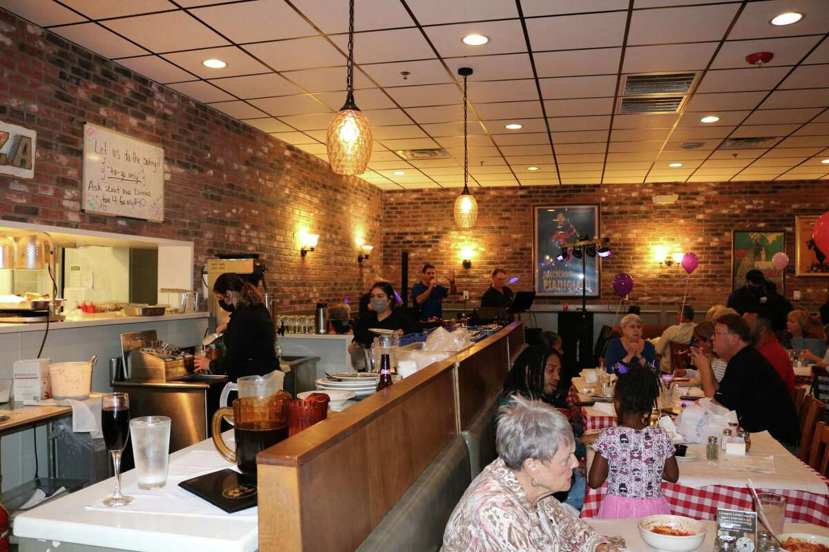 Diners at Lasagna House's 79th birthday party, 217D Cypress Creek Parkway.