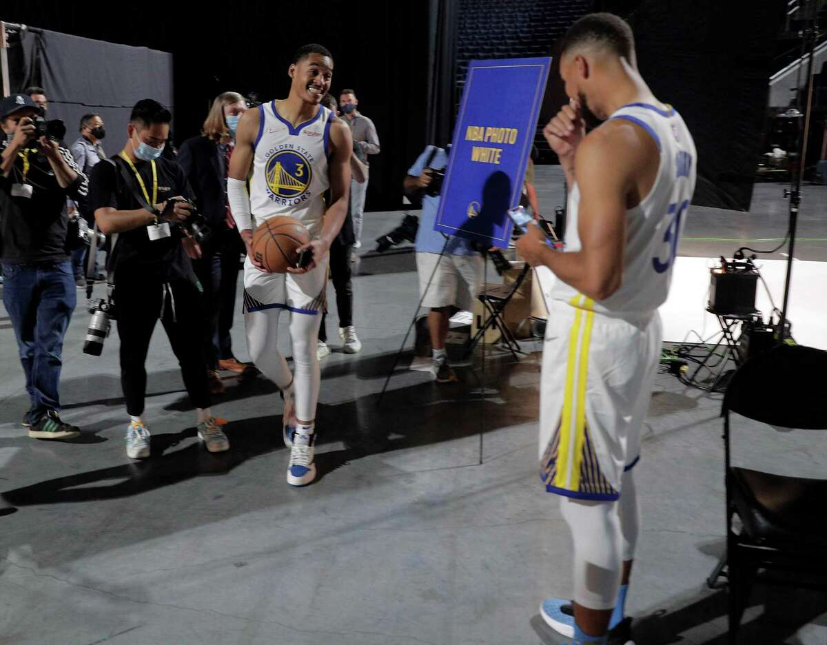 Jordan Poole goofs around with Stephen Curry after he had his portrait made as the Golden State Warriors held their media day for the 2021-22 season at Chase Center in San Francisco, Calif., on Monday, September 27, 2021.