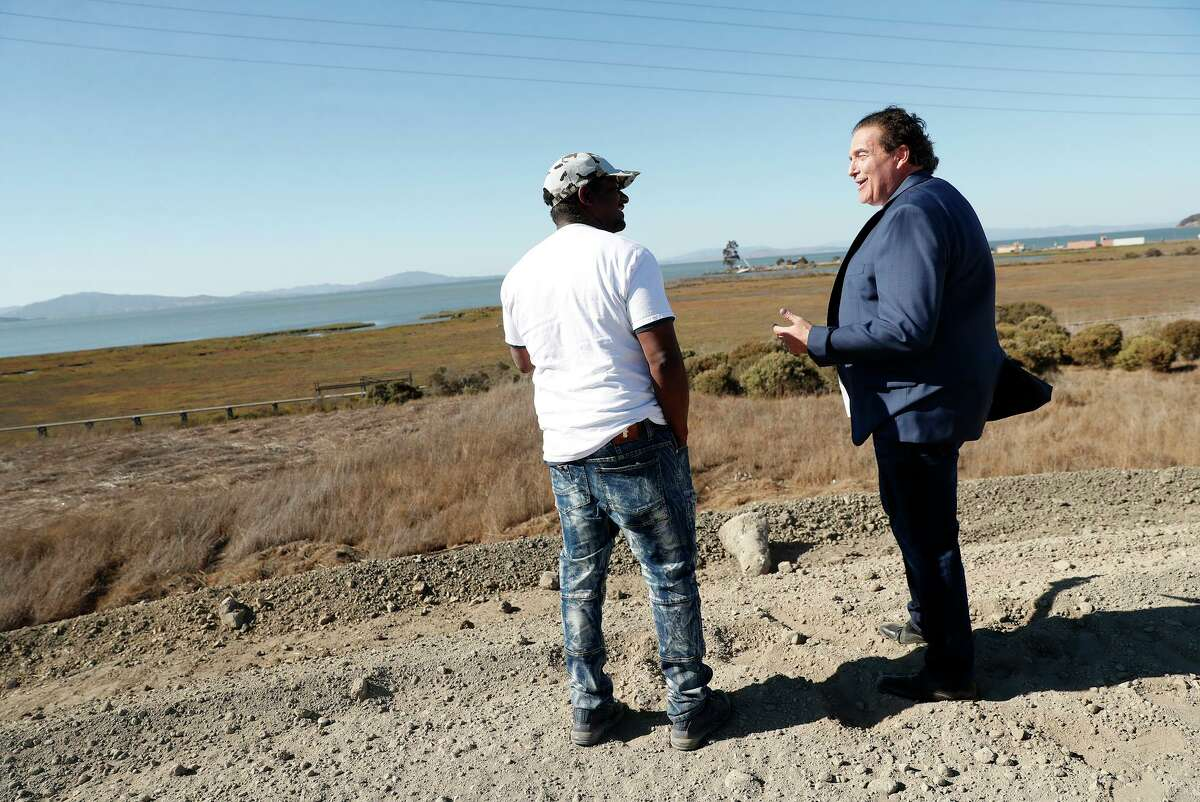 Richard Treiber (right) chats with equity partner Robert Livingston as they visit the site of a planned cannabis development.