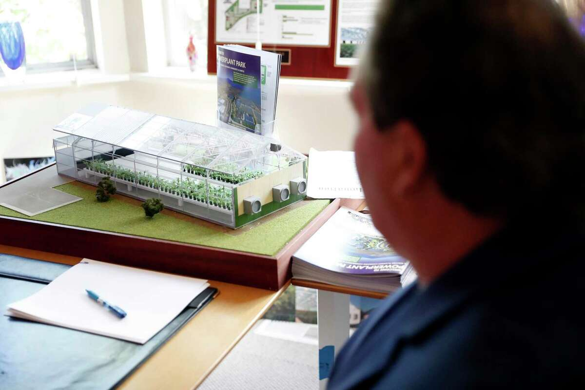 PowerPlant Park developer Richard Driver sits near a miniature greenhouse in his office in Richmond, California on Tuesday, September 29, 2021.