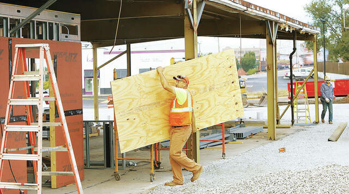 Work on a planned permanent food truck park location continues in Alton. On Friday, workers were carrying in plywood and starting to construct interior walls for the facility.