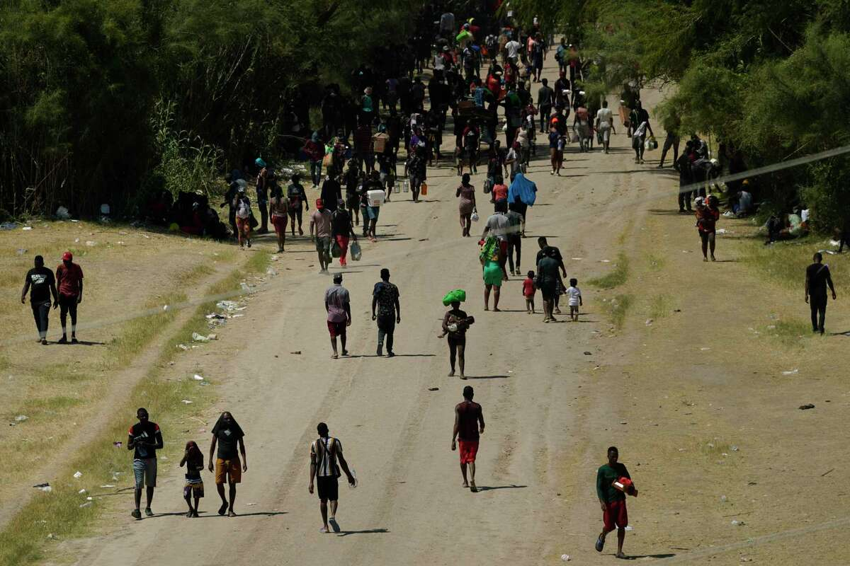 Haitian migrants move along a dirt road after crossing into the United States from Mexico last month. Readers continue to express their disgust with the treatment of Haitian asylum-seekers at the U.S.-Mexico border.