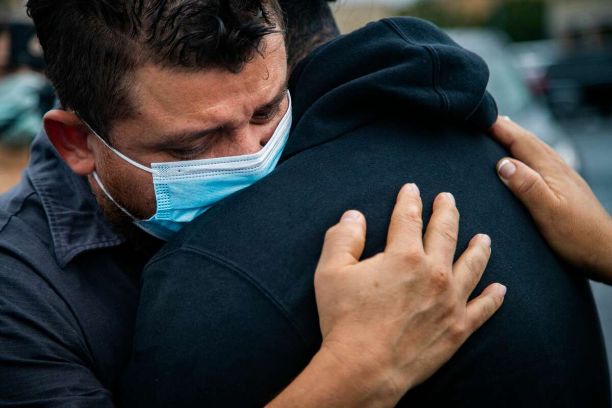 Miguel Granados embraces YES Prep Southwest Secondary school senior student Miguel Granados, 17, as they reunite at a parking lot on the corner of Hiram Clarke Rd. and W. Fuqua St. after a shooting took place at the school, Friday, Oct. 1, 2021, in Houston.
