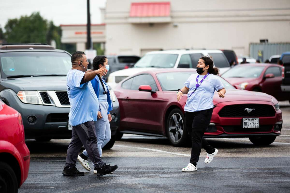 Yes Prep Southwest Secondary school student Kimberly Mendez, 14, rushes to embrace her father Rudis Mendez, 41, at a parking lot on the corner of Hiram Clarke Rd. and W. Fuqua St. after a shooting took place at her school, Friday, Oct. 1, 2021, in Houston.