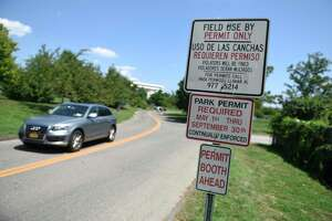 A sign notifies beachgoers that park permits are required at West Beach. The city's Parks and Rec committee is recommending eliminating the permits by 2023 to city residents with cars registered in Stamford and make up the drop in income with higher taxes.