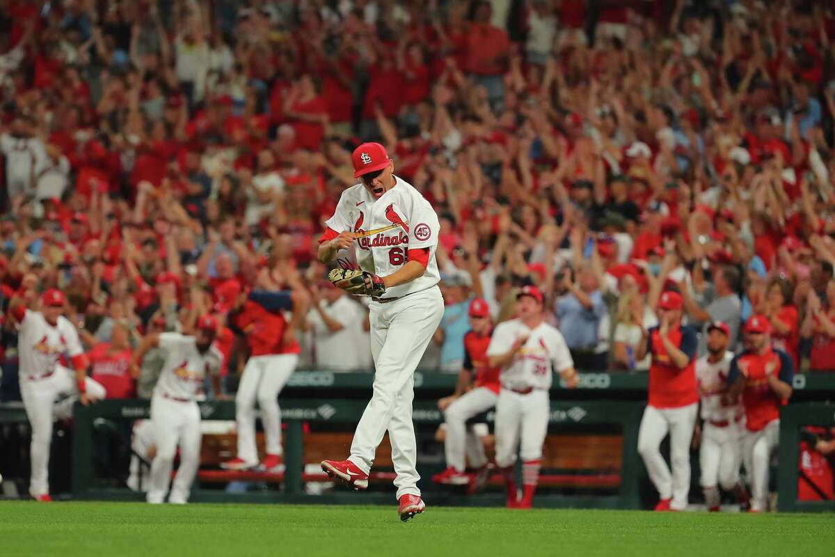 ST LOUIS, MO - SEPTEMBER 28: Giovanny Gallegos #65 of the St. Louis Cardinals celebrates after beatingthe Milwaukee Brewers in the ninth inning to clinch a wild-card playoff birth at Busch Stadium on September 28, 2021 in St Louis, Missouri. (Photo by Dilip Vishwanat/Getty Images)
