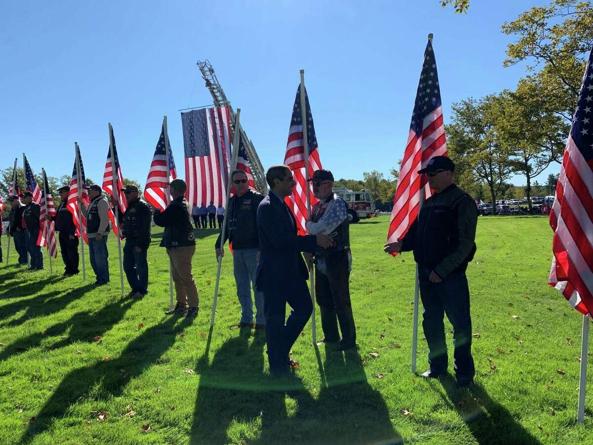 Over 100 people, mostly veterans, gathered at the State Veterans Cemetery in Middletown Friday to honor eight soldiers who never received a proper burial.