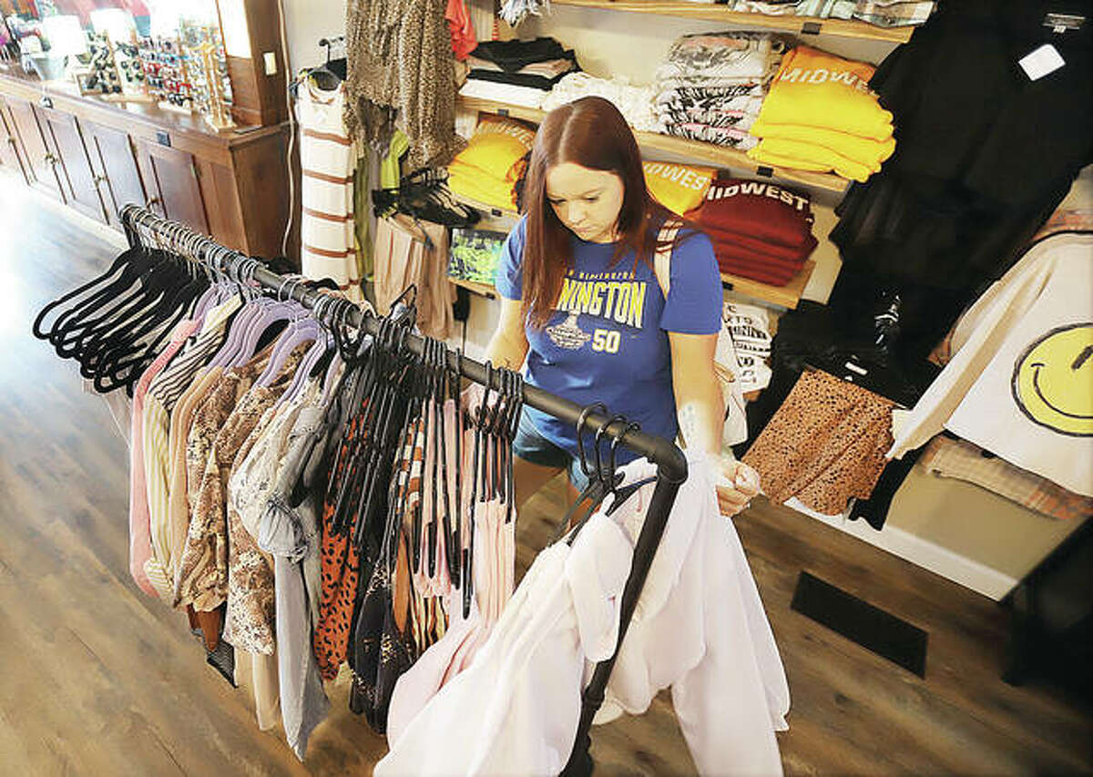 Melissa Ray of Bethalto shops inside The Co-Op at Klein Hall which opened Friday in the former Klein's building, 128 W. Central St., in Bethalto. The firm features 18 small businesses.