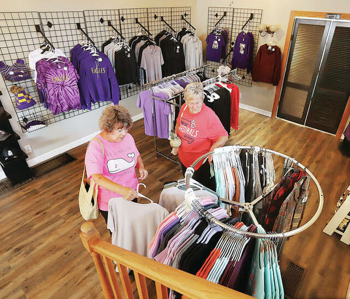 Diane Fielder, left, and Brenda Gibbons, right, both of Bethalto, shop Friday after the opening of The Co-Op at Klein Hall at 128 W. Central St. in Bethalto.