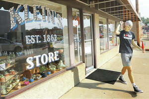 A shopper walks out of The Co-Op at Klein Hall Friday after the business opened in the location of the former Klein's store in Bethalto.