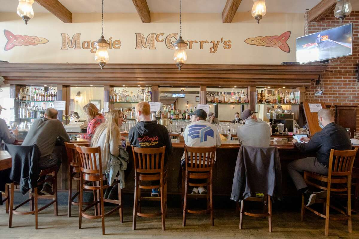 Customers sit at the bar at Maggie McGarry's in San Francisco, Calif., on Sept. 28, 2021.