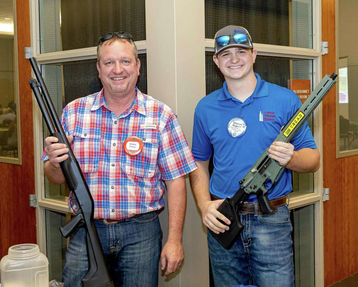 Double barrel fun. Conroe Noon Lions Club members Bobby Finley left and Mason Dupuis right are showing off two of the guns in the club's gun raffle which will take place at their annual Clay Shoot this Saturday, Oct. 9; for ticket information contact a club member or the club office.