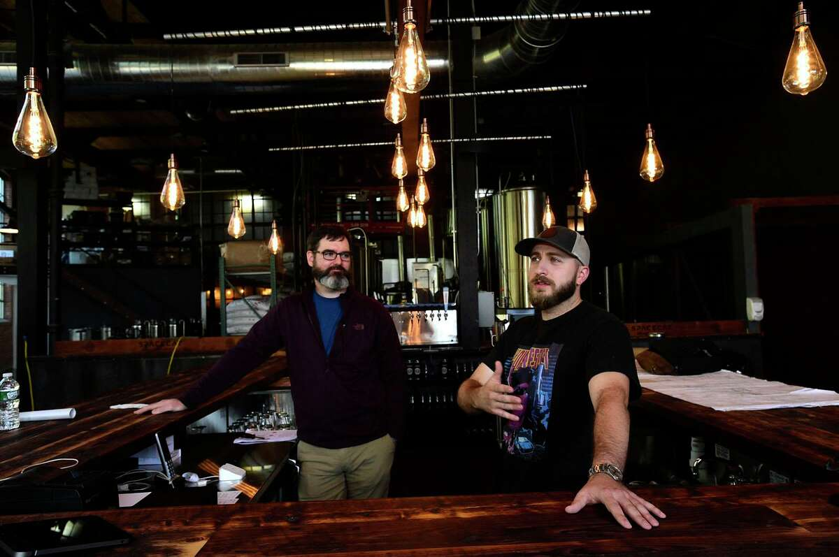 Spacecat Brewing owner James Bloom, right, and Operations Manager Jeff Dunn at the new brewery Friday, October 1, 2021, in Norwalk, Conn. Spacecat Brewing opens Friday in the onetime textile mill on Chesnut Street.