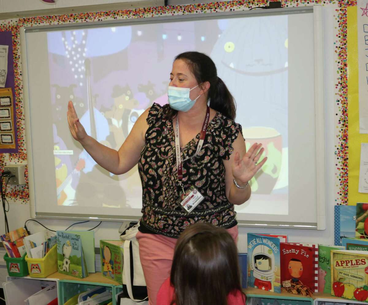 Elementary Spanish Teacher Eliza Smernoff, immerses her kindergarten class with songs and dance, all in Spanish, at Live Oaks Elementary School.