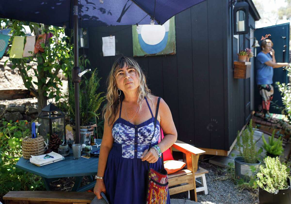 """Ruth Schwartz stands in front of a shed that she alleged in an eviction lawsuit her tenant Meghan Lewis (right) erected without permission and is now """"working and living"""" in. Schwartz said in the lawsuit that Lewis stopped paying rent in September 2019, and that she has been stuck """"in hell,"""" unable to evict Lewis during the pandemic."""