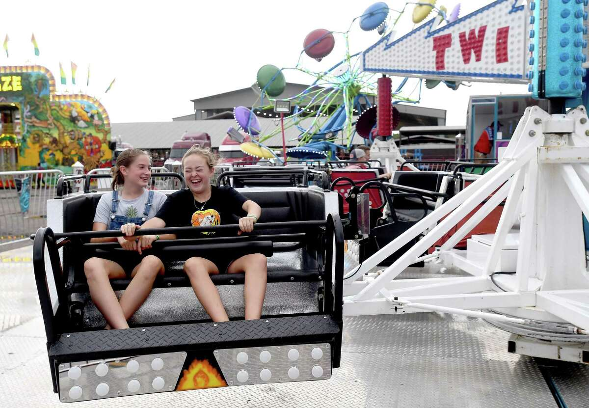 Festival-goers enjoy the carnival rides on the second night of the Texas Rice Festival in Winnie. Events, including the carnival, live music, pageants, exhibit halls and more continue through the weekend at Winnie Stowell County Park. Photo made Thursday, September 30, 2021 Kim Brent/The Enterprise