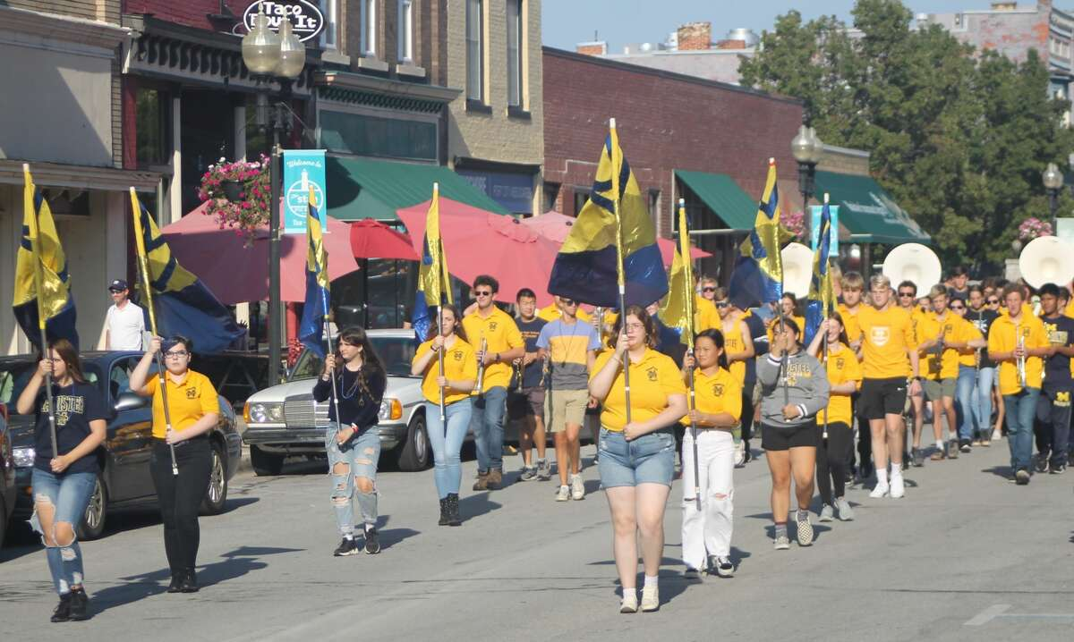 Manistee High School's homecoming parade makes its way down River Street on Friday afternoon.