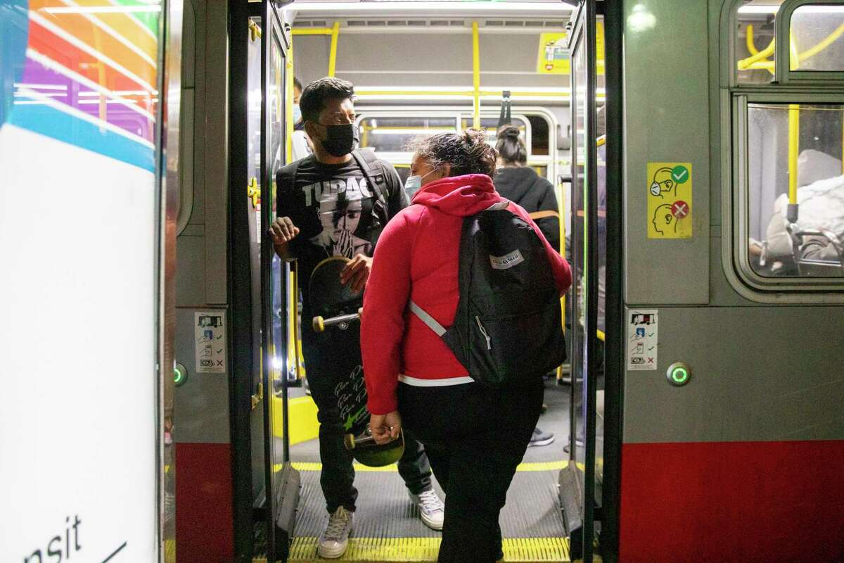 Juliana Gonzalez boards the 14-Mission line during Muni's owl service in June. The transit agency says it needs more funding to restore service to pre-pandemic levels.
