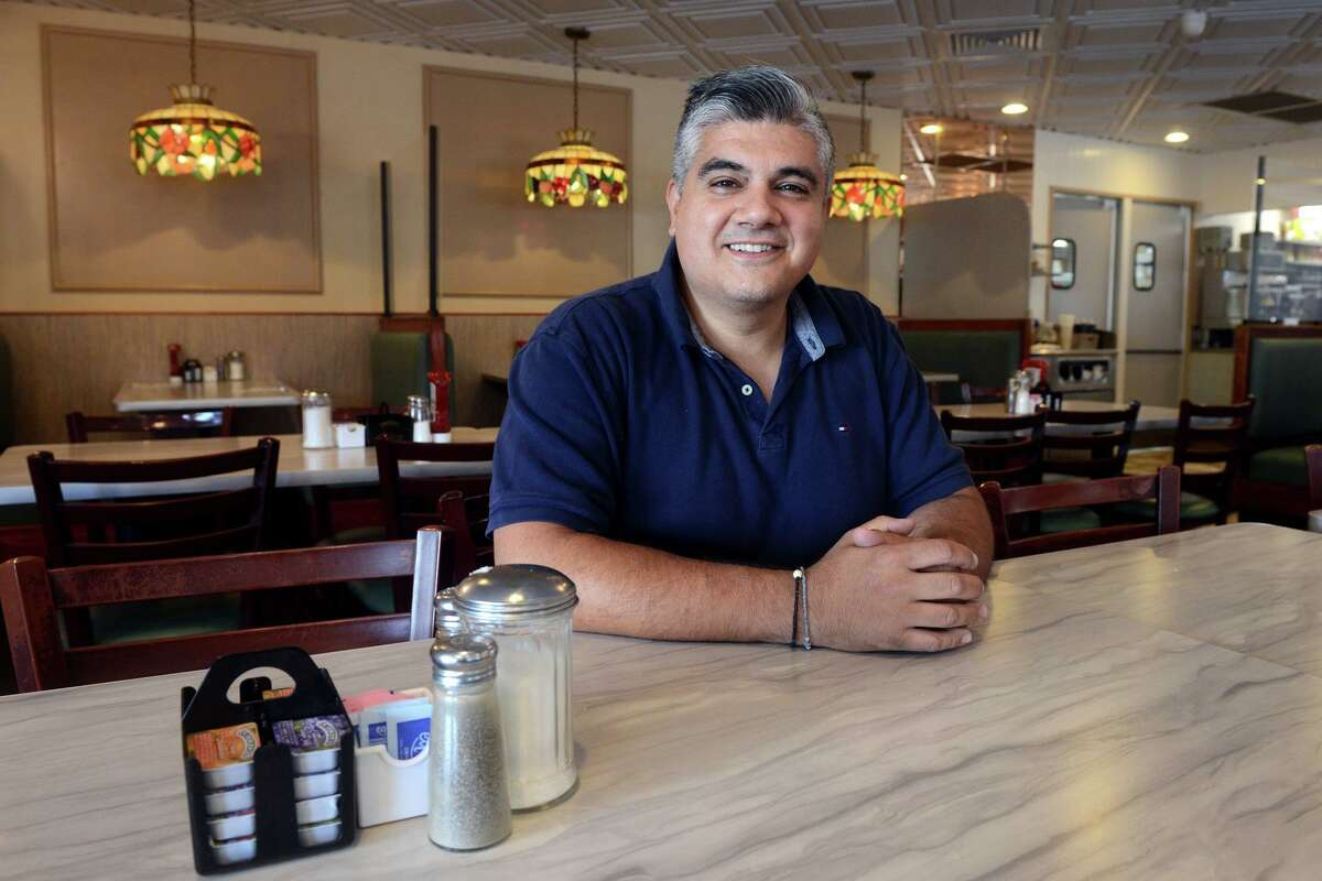 Owner Nick Roussas in the dining room at Frankie's Diner, in Bridgeport, Conn. Sept. 30, 2021.