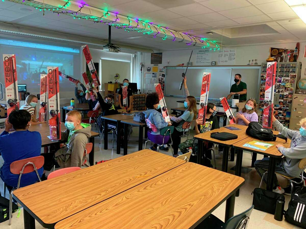 After completing a Junior Ranger Angler Program from the National Park Service, students in Frankfort Elberta Area Schools' 7th grade class received an official junior ranger badge and fishing equipment. (Courtesy Photo)
