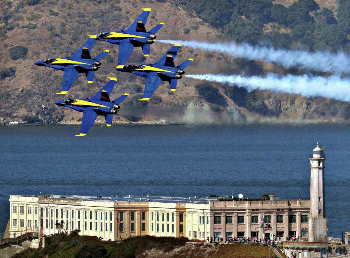 The Blue Angels practice their aerial maneuvers over Alcatraz Island and the San Francisco Bay, as seen from the Fairmont Hotel in San Francisco on Oct. 10, 2019.