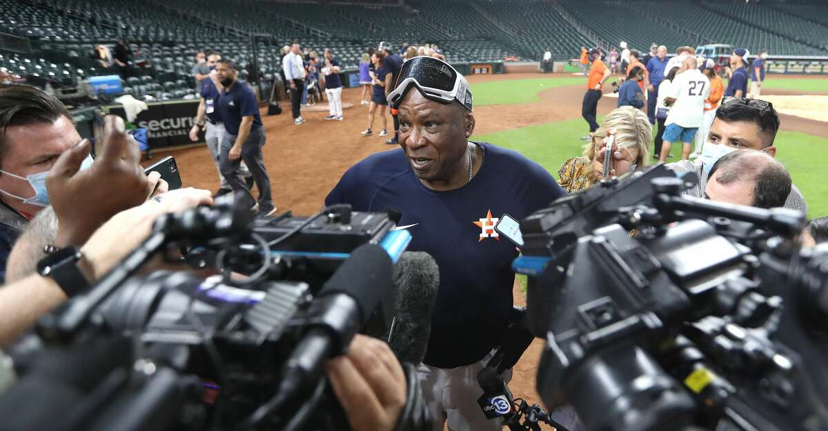 Houston Astros manager Dusty Baker Jr. is interviewed on the field wearing his champagne soaked goggles after Houston clinched the AL West with their 3-2 win over Tampa Bay Rays after an MLB baseball game at Minute Maid Park, Thursday, September 30, 2021, in Houston.