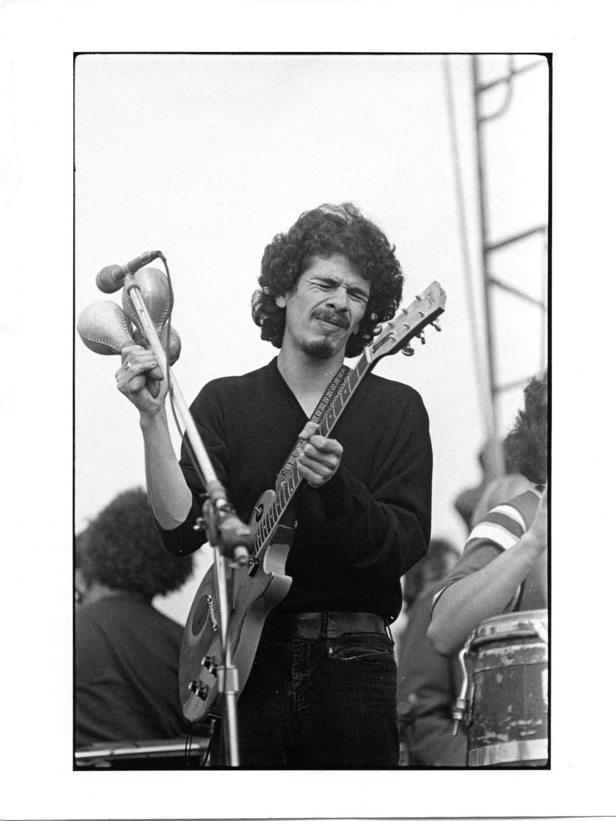 Carlos Santana at Altamont in December 1969, by Robert Altman.