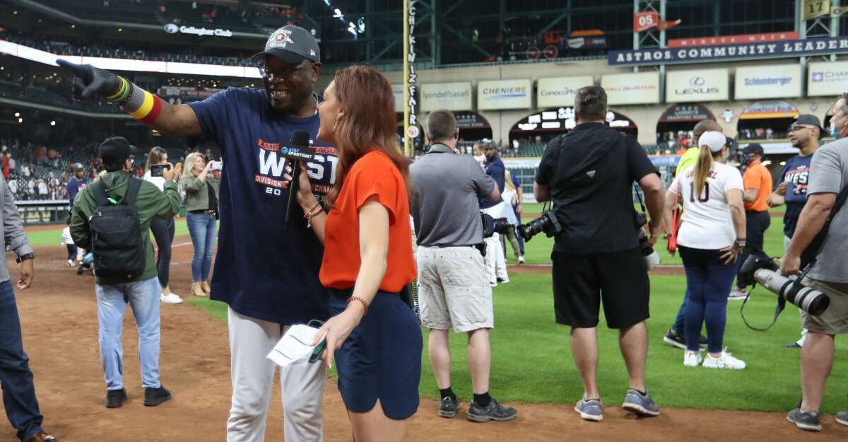 Houston Astros manager Dusty Baker Jr. (12) does an interview with Julia Morales after Houston clinched the AL West with their 3-2 win over Tampa Bay Rays after an MLB baseball game at Minute Maid Park, Thursday, September 30, 2021, in Houston.