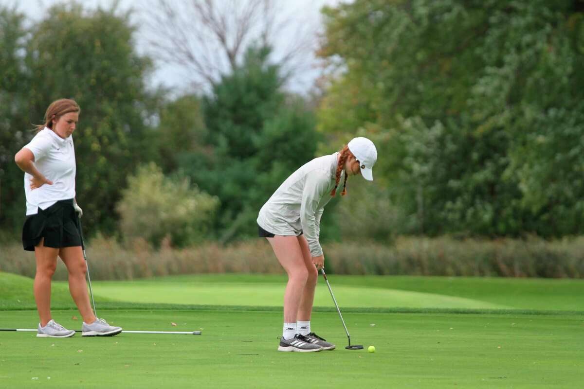 Manistee sophomore Kendal Waligorski sets up for a putt at the Chippewas home competition. (McLain Moberg/News Advocate)