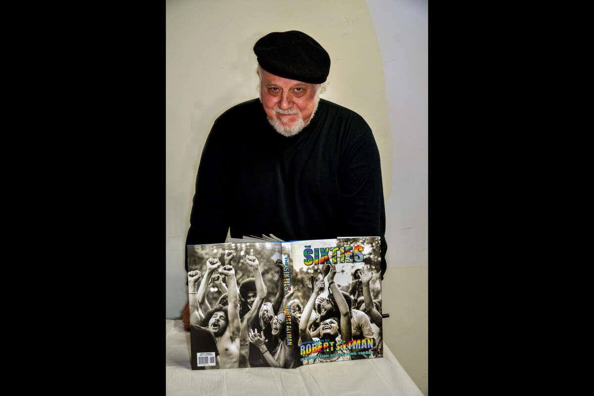 """Robert Altman with his book """"The Sixties"""" in 2013"""
