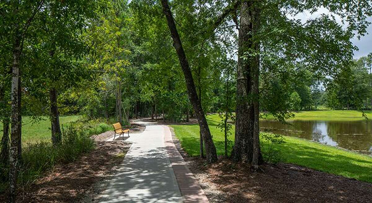 The winding path alongside Patio Park Lake in the new Royal Brook community. The final village in the Kingwood area is already about half done.