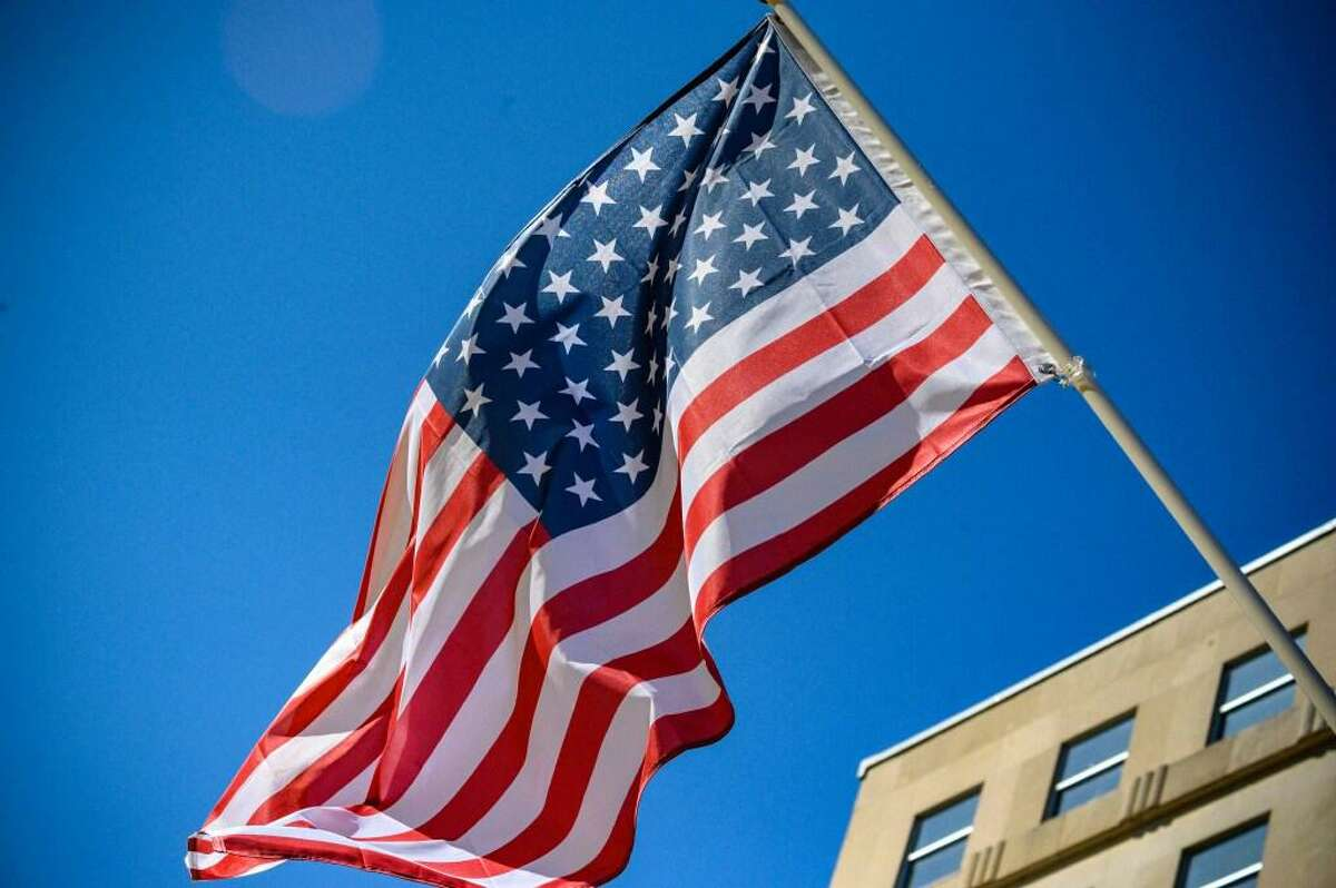 U.S. Stars and Stripe flags with 51 stars (an extra star for the District of Columbia) are set up on poles on Black Lives Matter Plaza next to the White House.
