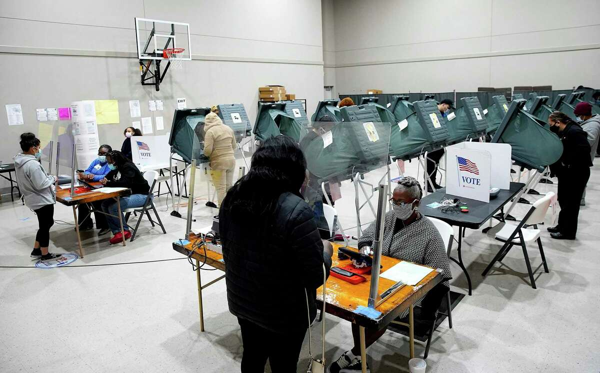 FILE - Voters cast their ballots for the general election at Victory Houston polling station, one of Harris County's 24-hour locations, in Houston, on Friday, Oct. 30, 2020.