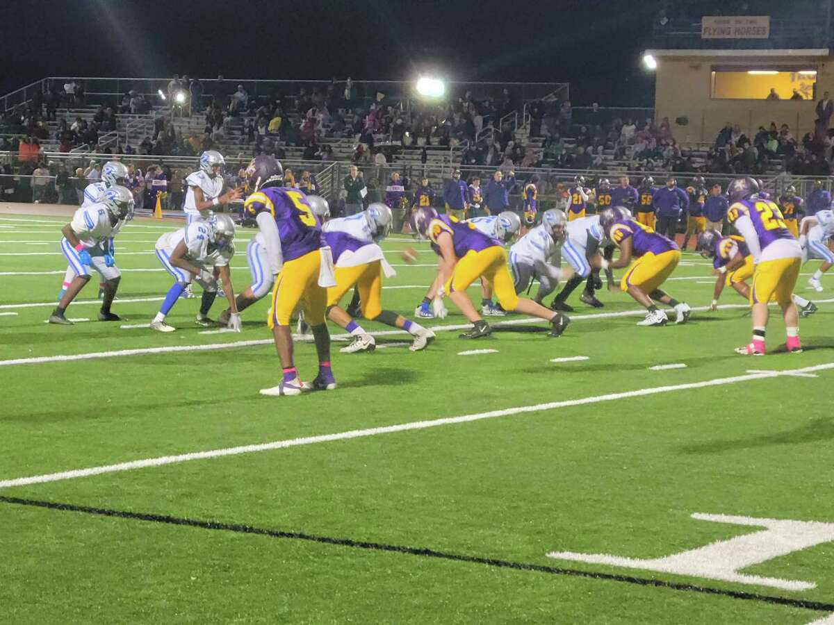 Albany and Troy line up for a play in their Class A game on Friday night, Albany's first game of the season.